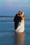 Bride and groom strolling on beautiful Coquina Beach in Nags Head, NC
